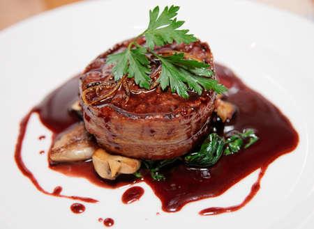 Tenderloin steak wrapped in bacon with demi-glace sauce 免版税图像