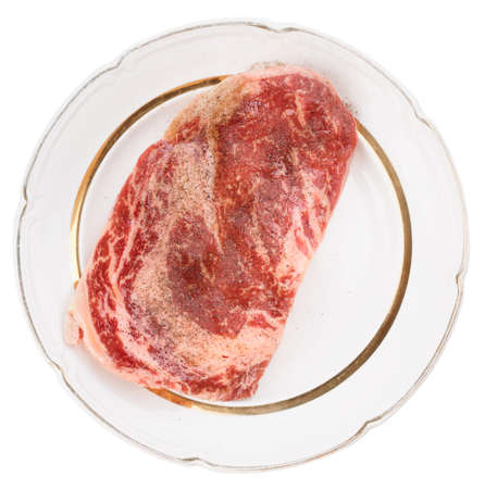 oiled: Premium quality ribeye steak oiled and peppered for frying Stock Photo