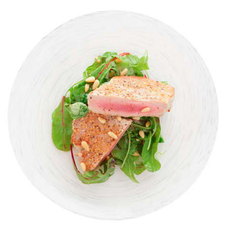pine nuts: Lightly seared tuna steak with sesame and fresh salad isolated on white Stock Photo