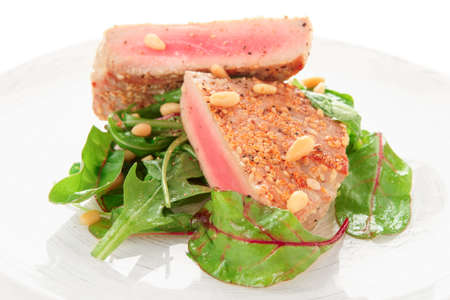 Lightly seared tuna steak with sesame and fresh salad photo