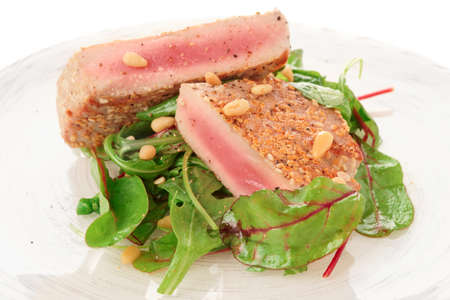 ahi: Lightly seared tuna steak and fresh salad Stock Photo