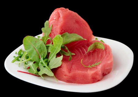 ahi: Tuna steaks with salad isolated on black background
