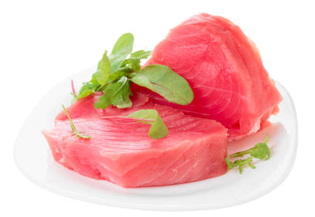Tuna steaks with salad isolated on white background photo