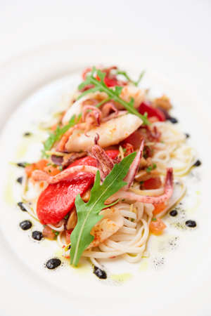 seared: Pasta with seafood and squid ink on porcelain plate