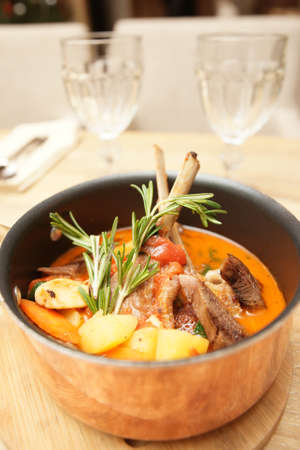 stew pot: Stewed rack of lamb with vegetables in copper pot
