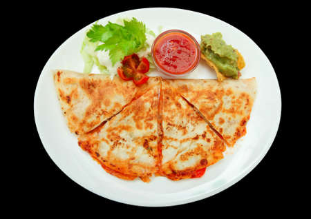 mexican black: Quesadilla isolated on black background Stock Photo