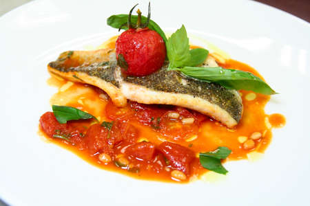 Seabass fried with vegetables on plate Foto de archivo