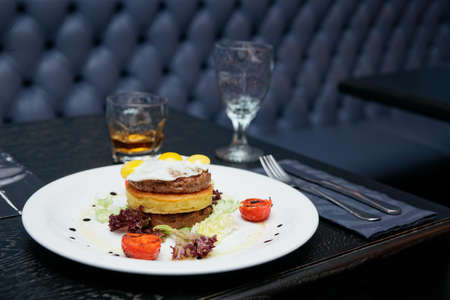 Burger with potato patty and omelette - pub food photo