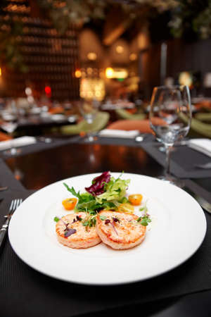 shallow focus: Seafood cutlets on table in a restaurant, shallow focus depth Stock Photo