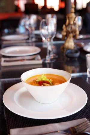 gaspacho: Bowl of pumpkin soup on restaurant table