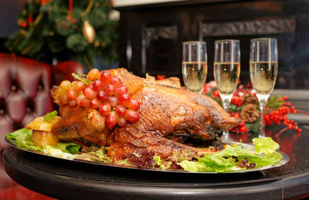 Roasted thanksgiving turkey on restaurant table with champagne photo
