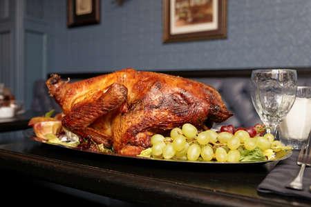 Roasted turkey on a restaurant table photo