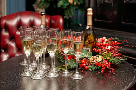 Glasses with champagne on table, winter holiday setting Stock Photo - 25085041
