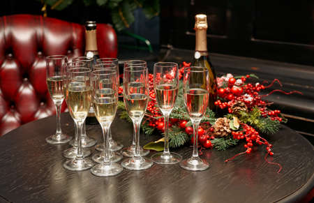 Glasses with champagne on bar lounge table Stock Photo - 25085042