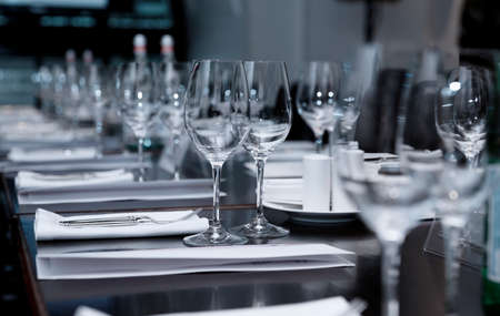the official: Table set for official dinner, focus on glasses