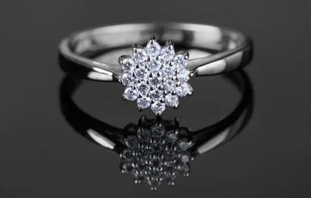 white gold: White gold ring with diamonds shot on grey surface, macro Stock Photo