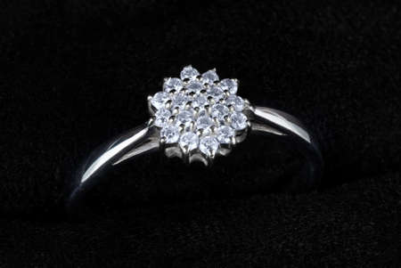 white gold: White gold ring with diamonds isolated on black, macro Stock Photo