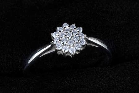 shiny black: White gold ring with diamonds isolated on black, macro Stock Photo