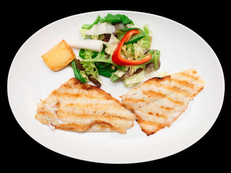 seabass: Grilled seabass fillet in plate, isolated on black background