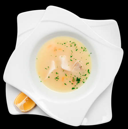 cuisines: Fish soup cooked in mediterranean style on table isolated on black Stock Photo