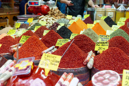 Heaps of spices on asian market stall photo
