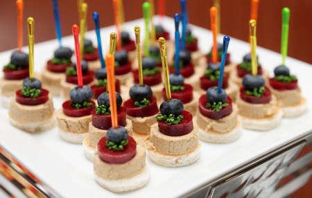 foie gras: Snack of foie gras and marmalade on platter