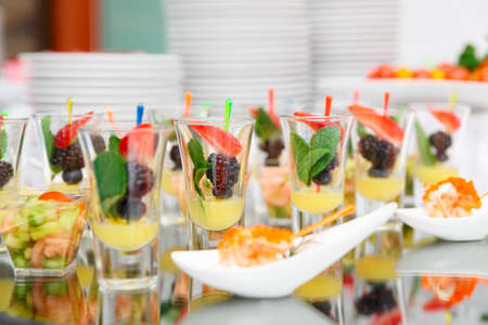 veggie tray: Berry dessert in shot glasses on banquet table