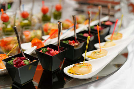 Various snacks on table, banquet food photo