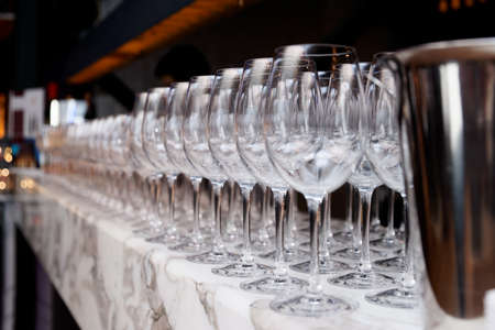 bar counter: Rows of wineglasses on bar counter Stock Photo