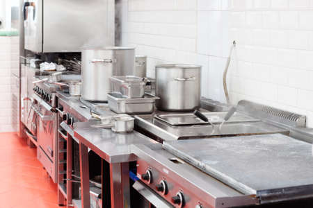 tiled stove: Typical kitchen of a restaurant shot in operation