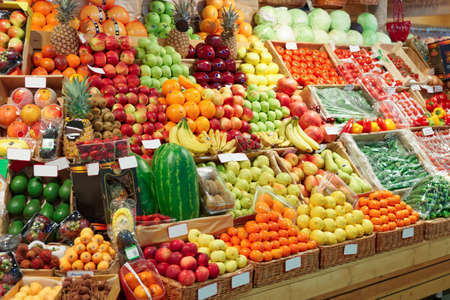 Shelf with fruits on a farm market, trademarks blurred or removed