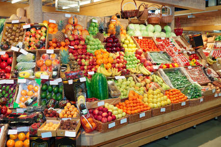 Shelf with fruits on a farm market, trademarks blurred or removed photo