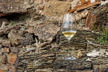 Glass of Riesling wine on a slate rock photo