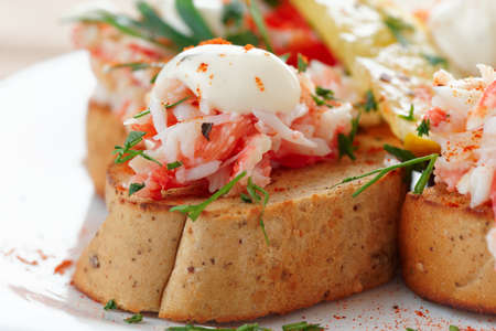 crab meat: Crab meat with toast, sauce and fresh herbs, close-up