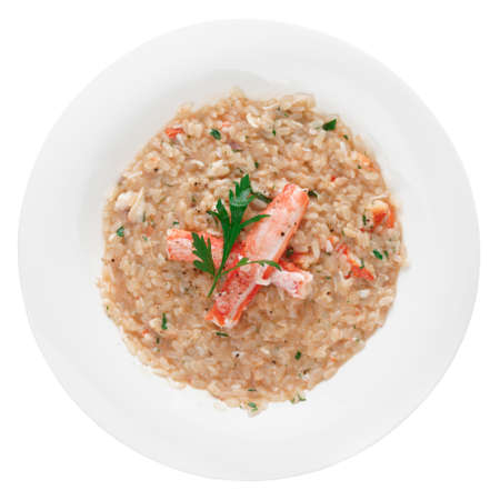 crab meat: Risotto with crab meat and herbs, isolated on white