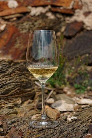 Glass of Riesling wine on a slate rock