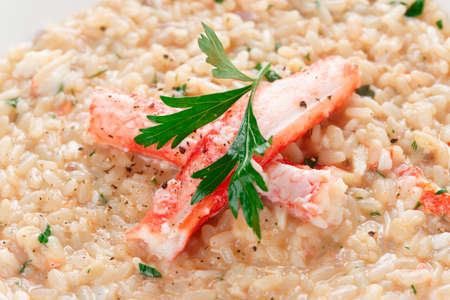 crab meat: Risotto with crab meat and herbs, close-up