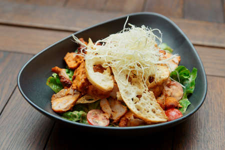 fine dining: Appetizer with grilled chicken fillet, cheese and croutons  Stock Photo