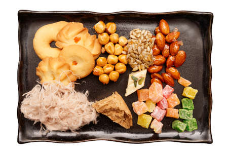 Oriental sweets on plate shot from above isolated with clipping path photo