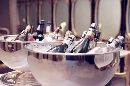 champagne bottle: Bowls with iced champagne, toned