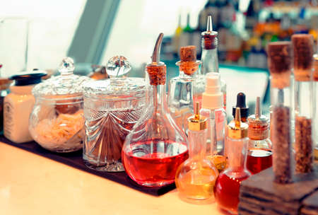 Bitters and  infusions on bar counter, toned photo