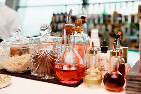 Infusions and spices on bar counter, toned photo