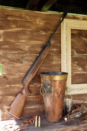 old rifle: Hunting style decoration of a summer house
