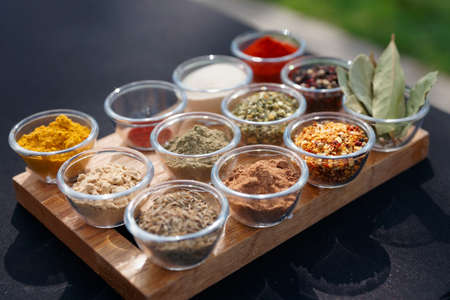 Set of various spices on table photo