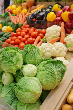 Vegetables and groceries on market display photo