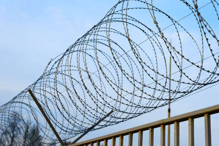 access restricted: Fence with barbed wire, restricted access zone