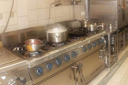 messy kitchen: Real restaurant kitchen shot in operation, haze effect Stock Photo