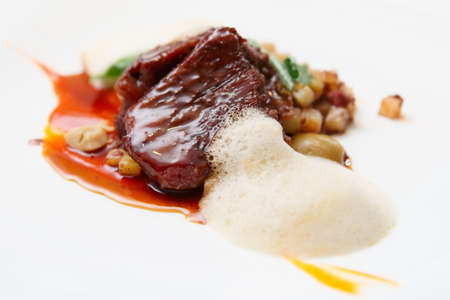 wine sauce: Delicious veal fillet served with wine sauce, molecular froth and potato Stock Photo