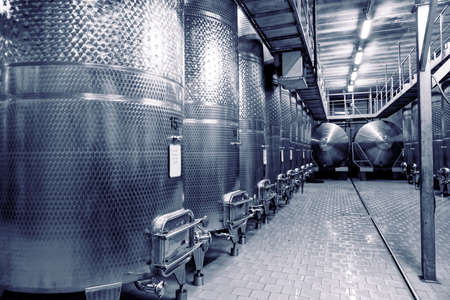 fermenters: Stainless steel fermenters used to make wine, toned image