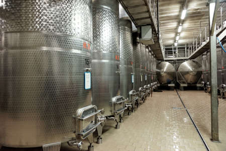 fermenters: Large volume stainless steel fermenters used to make wine